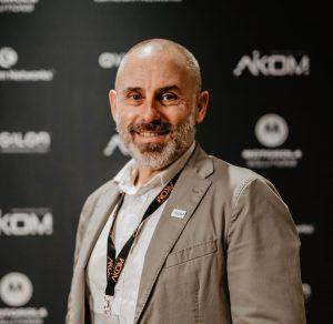 Mauro Renzi, Aikom